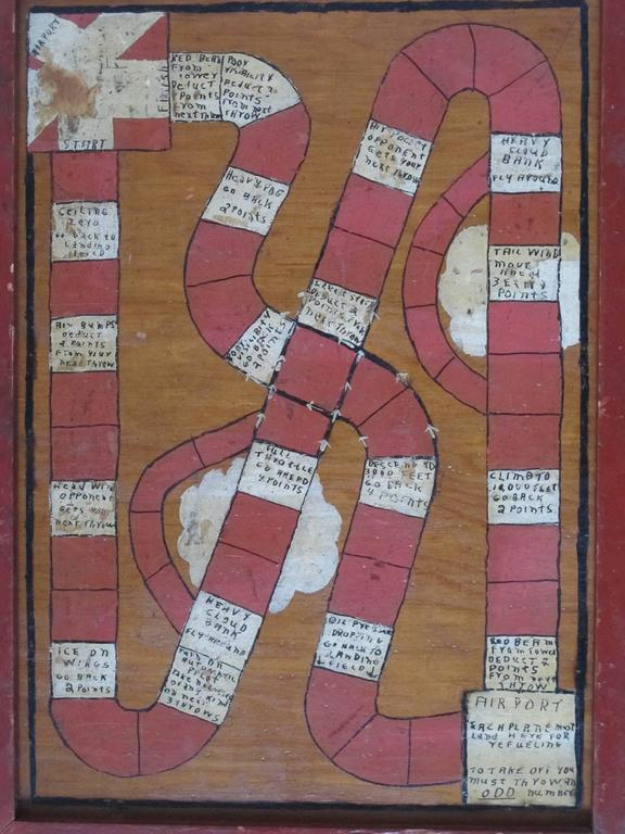 Homemade game painted on framed wood panel. The game is played by throwing dice to move along a twisted path with some stops offering specific instructions. I've never seen a game like this before. Hand-painted outlined and lettered.