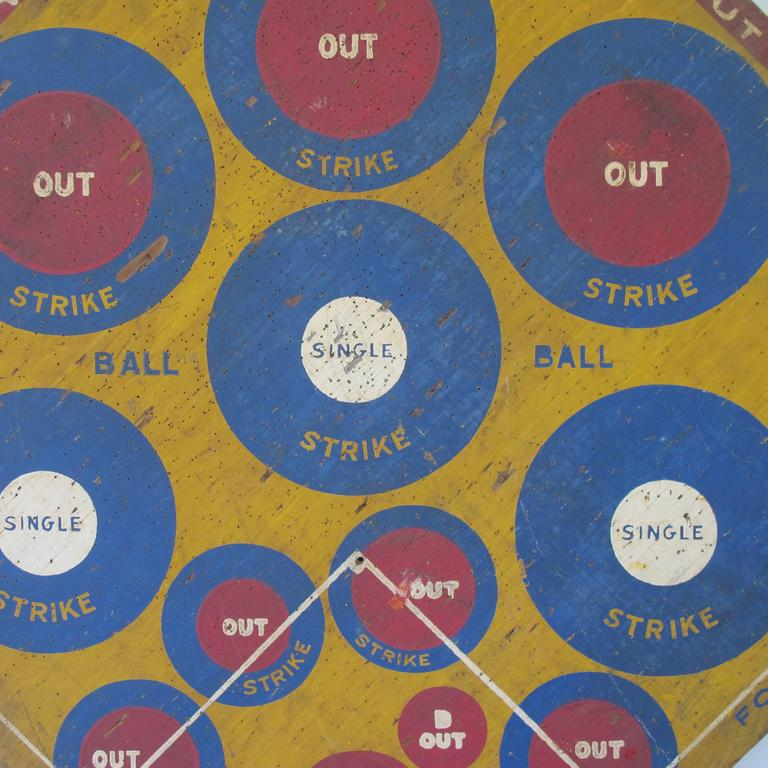 Graphic dart game board with painted circles for pitches, hits and outs. A golf game equally graphic painted on reverse side. Marked Rainshine Golf, copyrighted by E.W. Love, Joplin Mo.1932.