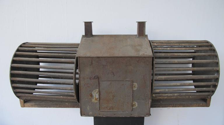 Sculptural Tin Squirrel House With Double Wheels For Sale
