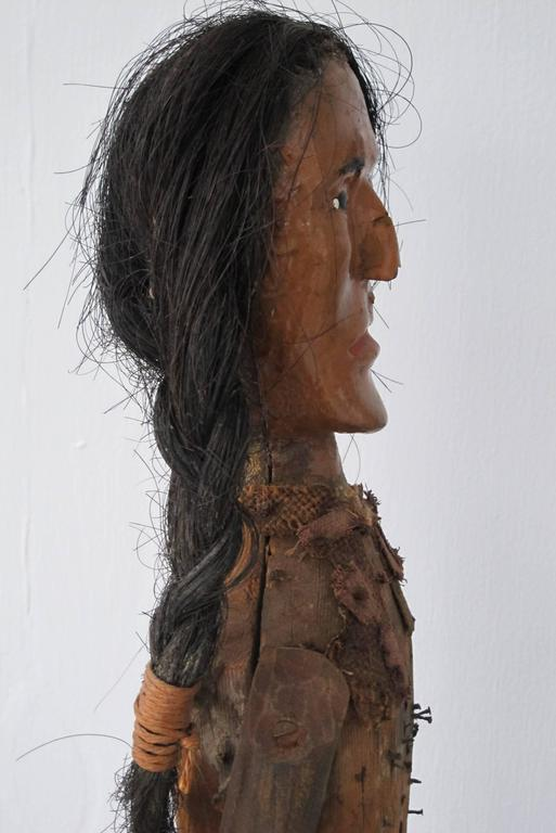Folk art indian of carved wood with braided hair at stdibs