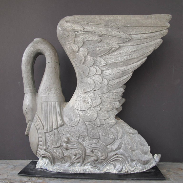 Sculptural large swan mold with intricate detailing. The swan mold is made in two pieces and wired together and has been mounted on a metal base.