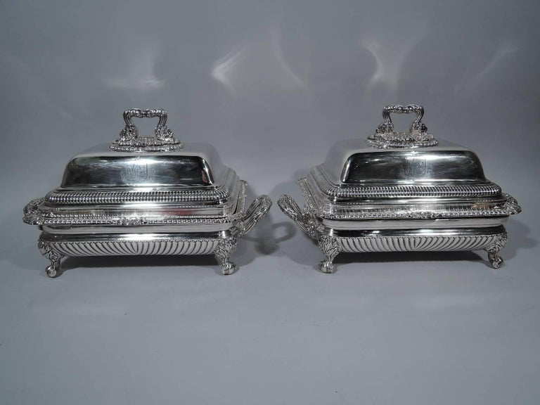 Pair of Regency sterling silver covered dishes. Made by Paul Storr in London in 1817. Each: Rectangular bowl has gadrooned rim with leaves and scallop shells. Double-domed cover has gadrooning and leaf bracket handle with lion's heads mounted to