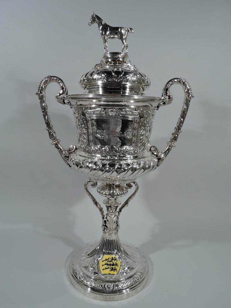 Victorian sterling silver trophy cup. Made by Blanckensee & Sons in Birmingham in 1895.  Bellied urn has beaded and leaf-wrapped scroll handles with leaf mounts. Beaded knop on plan shaft surrounded by leaf-capped and beaded leaf scrolls