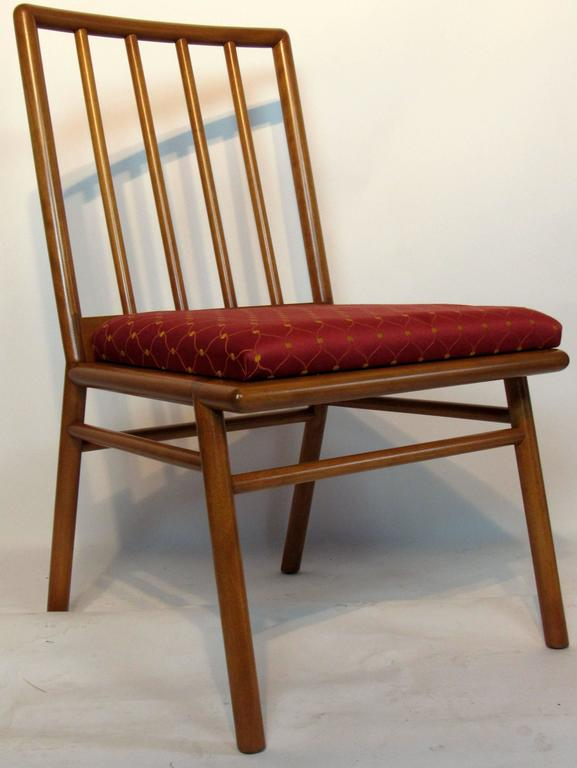 T.H. Robsjohn-Gibbings set of six walnut spindle back dining chairs for Widdicomb, circa 1952. The chairs are in excellent condition with original upholstery.