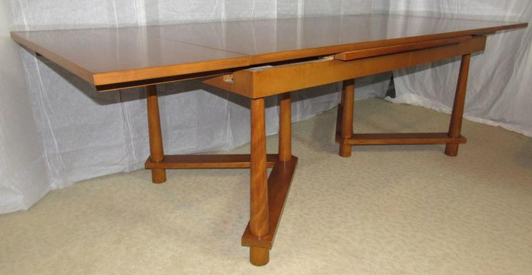 T. H. Robsjohn-Gibbings dining table with pullout end leaves on twin tripod bases with reverse tapered legs.  One of Robsjohn-Gibbings scarcer designs this model 1626 walnut table was manufactured by Widdicomb in September of 1950.  The table