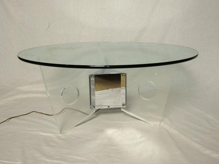 Wonderful light up coffee table which can be lit by any color bulb or just a clear bulb to accentuate the Lucite fins. Very cool, Studio 54, bright lights, Big City, Miami Vice. The table is in excellent condition.