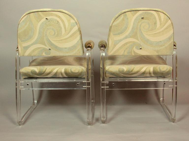 A pair of comfortable Lucite lounge chairs manufactured in the 1970s by Hill Industries. The chairs are in excellent condition.