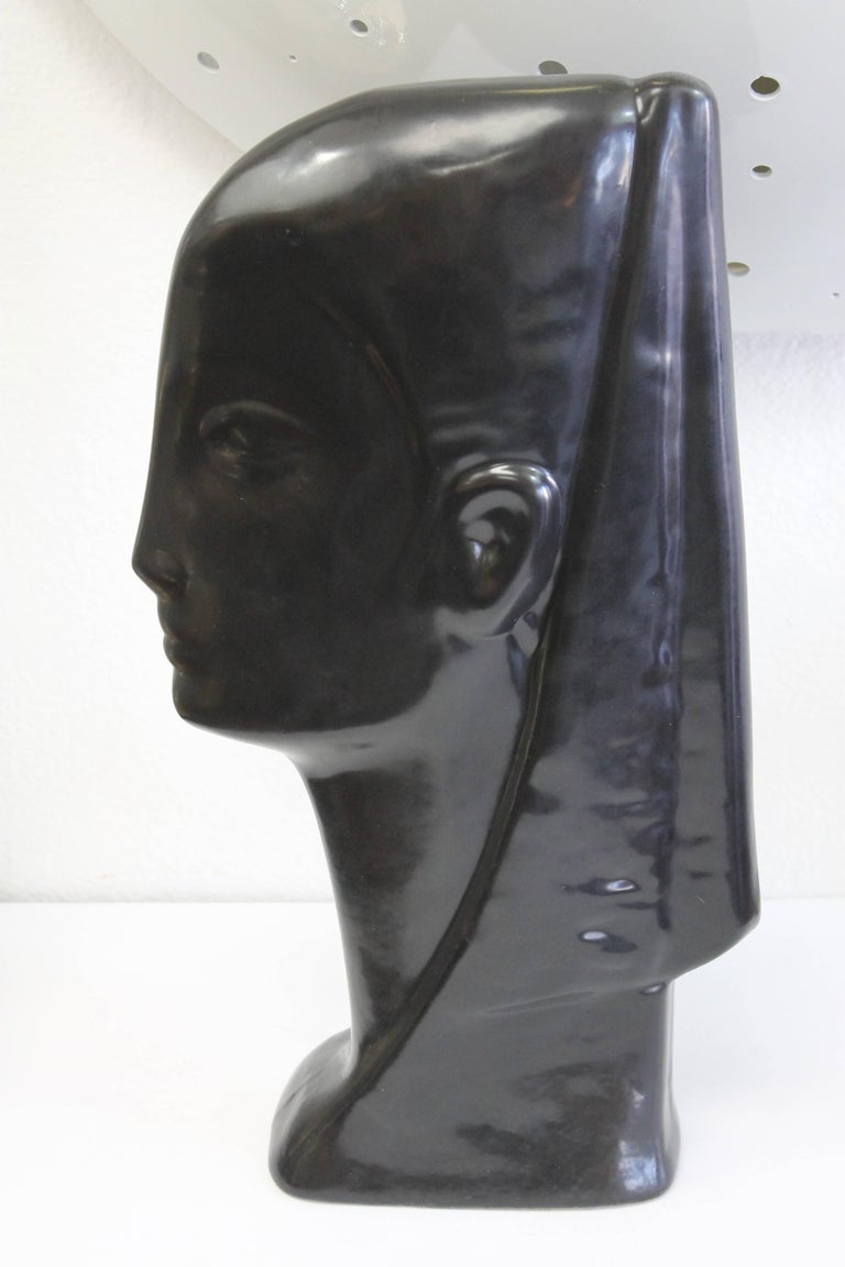 Egyptian inspired ceramic bust, dated 1957 and signed. We cannot make out the signature.