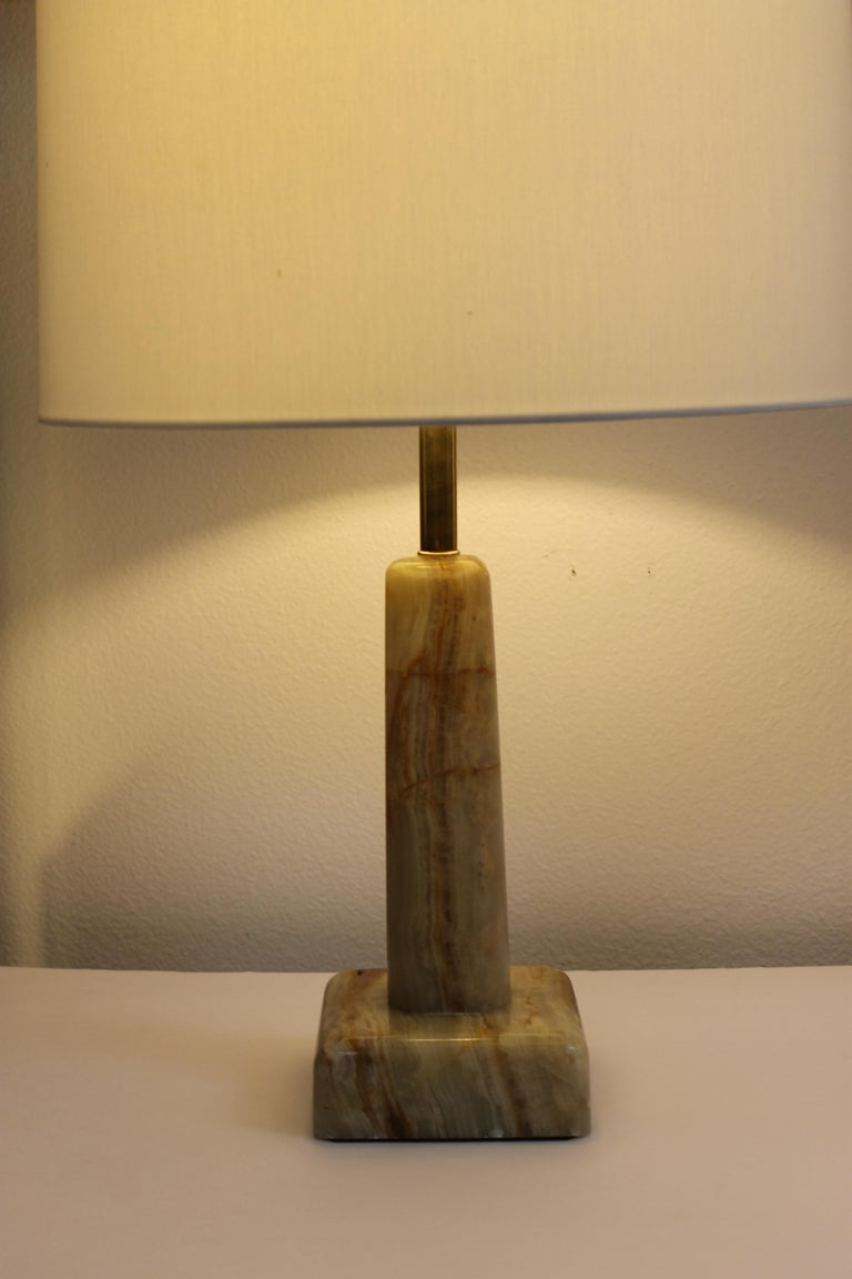 Pair of onyx lamps with different variations of browns. We've updated them by adding 3