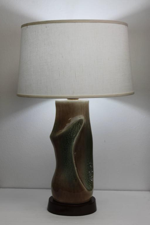"""Pair of ceramic lamps with different shades of greens and browns. Reminiscent of lamps by Marianna von Allesch. Ceramic portion is 17"""" high. Total height from base to the bottom of socket is 20"""". Base is 8.5"""" wide, 6.75"""" deep and"""