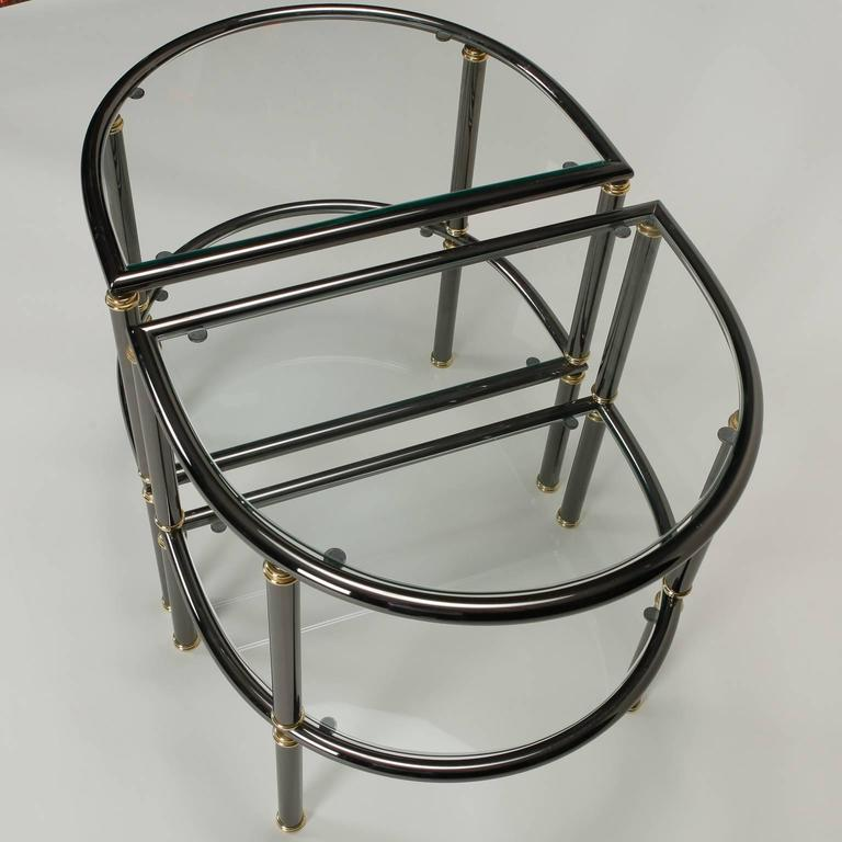 European Pair of Mid-Century Demilune Gun Metal and Glass Side Tables For Sale