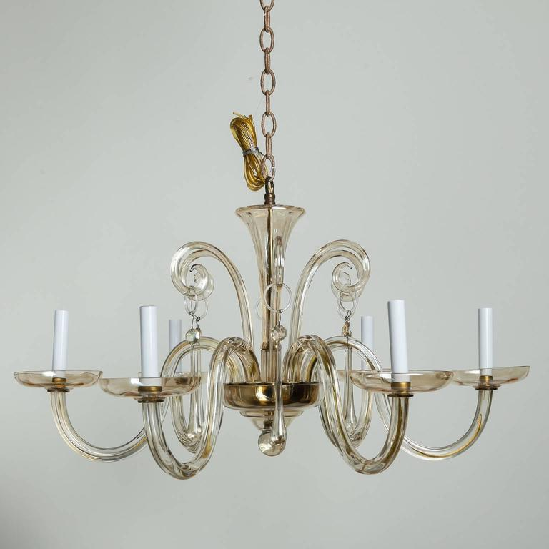 Six-light chandelier in pale amber Murano glass, circa 1960s. Sleek, clean lines with glass center shaft and bobeches and candle style lights. New wiring for US electrical standards.