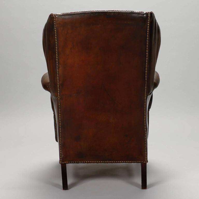 English Brown Leather Tufted Library Chair, Circa 1920s. Chair Has Tufted  Seat Back,