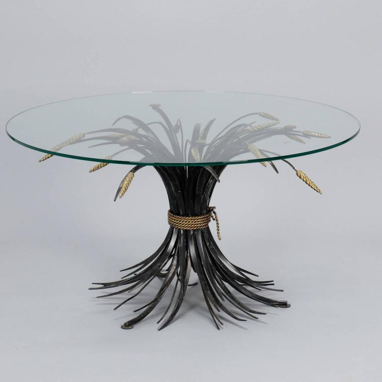 """Found in Italy, this circa 1940s table has a metal base in the form of wheat sheaf gathered with braided rope. Unusual finish with black stems and contrasting gilded rope and wheat grains. Round glass top is 26"""" diameter, this base could support a"""