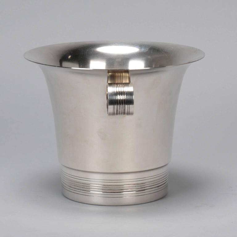 Silver plate wine cooler/ice bucket found in Italy, unknown origin, circa 1950s. Classic lines with subtle flared lip, looped handles and ridged design at base.