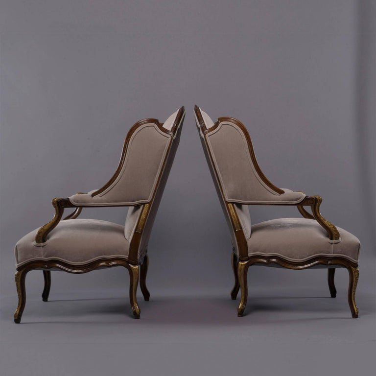 20th Century Pair of French Walnut Wing Chairs with Gilt Detailing For Sale
