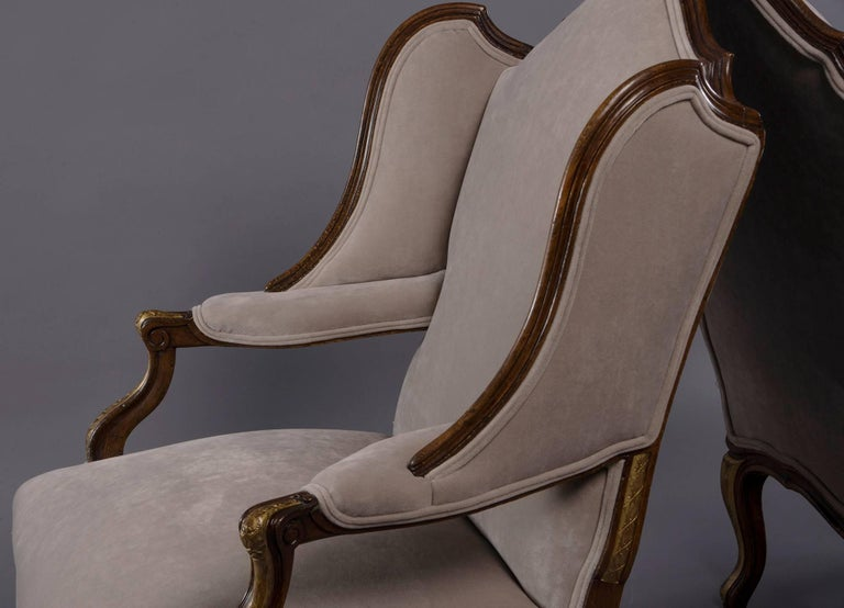 Upholstery Pair of French Walnut Wing Chairs with Gilt Detailing For Sale