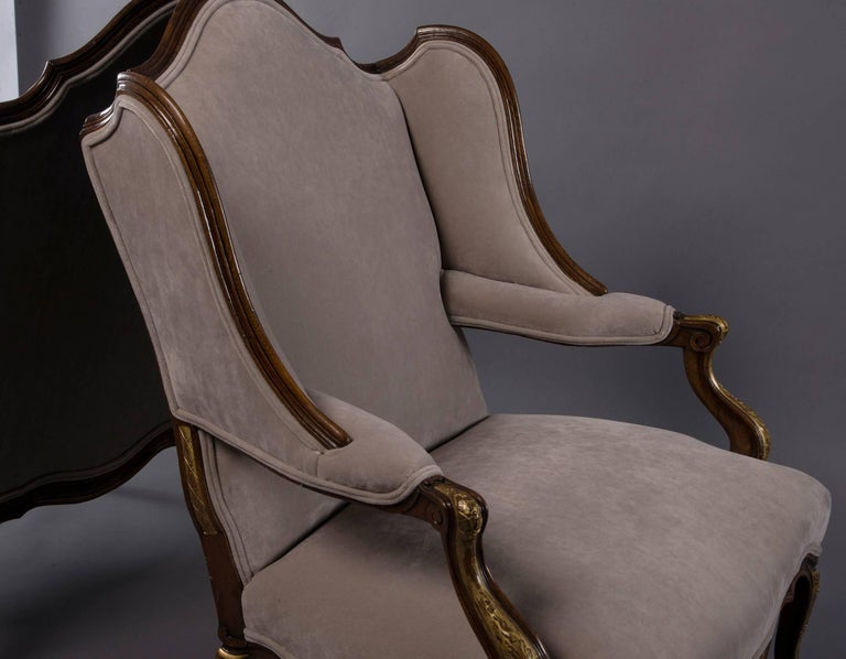 Pair of French Walnut Wing Chairs with Gilt Detailing For Sale 1