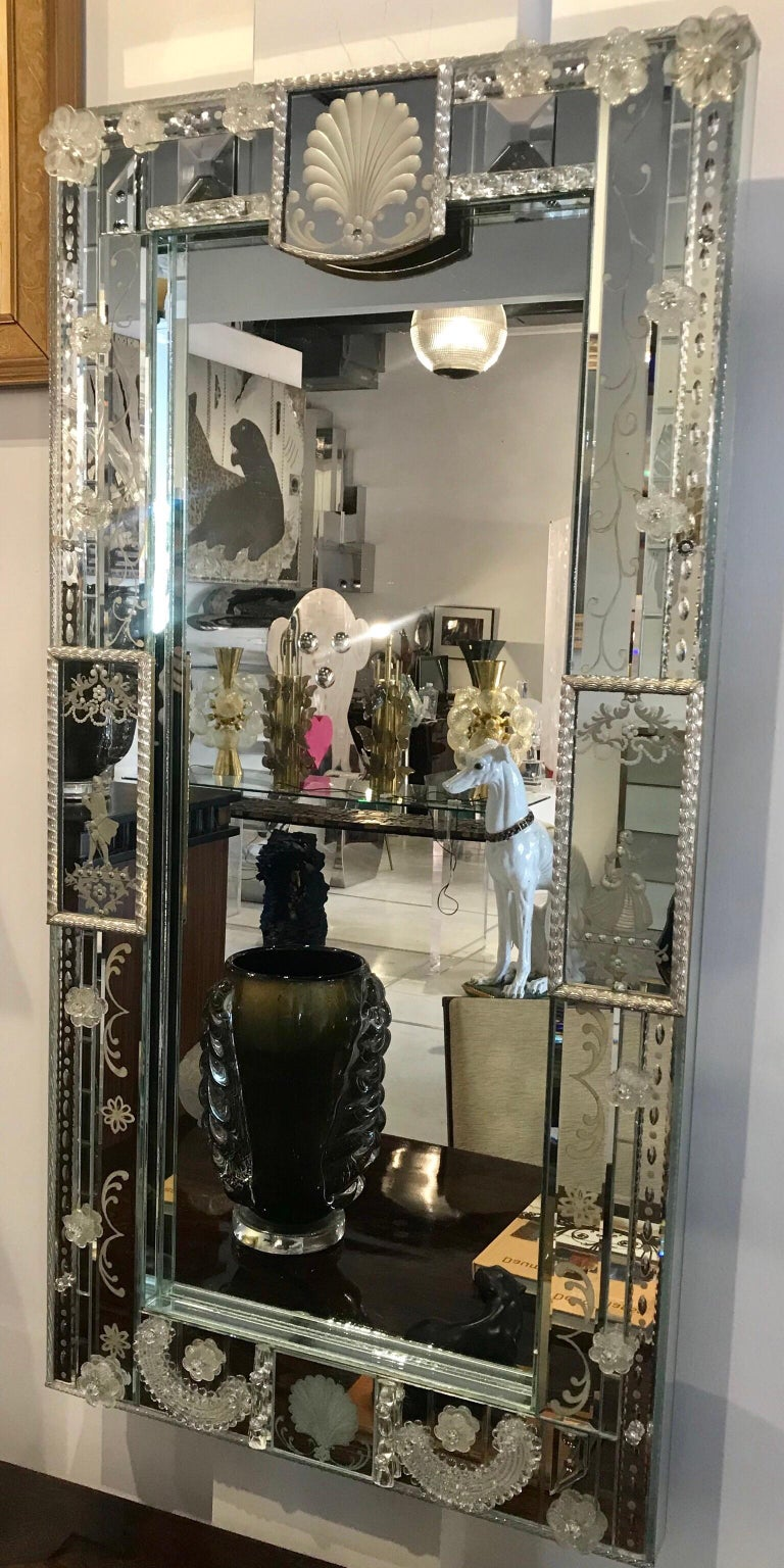 A very chic patchwork of mid century venetian mirror with floral venetian glass applications. Absolutely beautiful motifs and in fabulous condition.