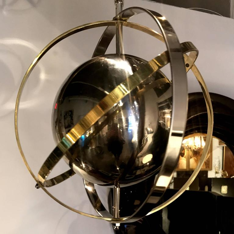 Mid-Century Modern Pair of Brass, Stainless Steel and Lucite Armillary Sphere Chandeliers For Sale
