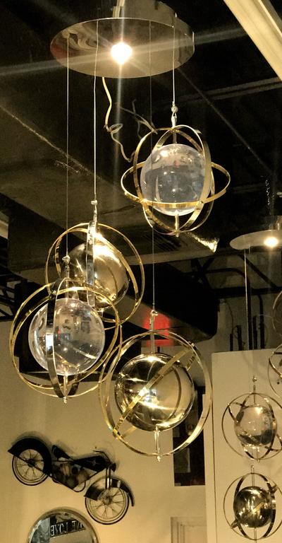 Pair of Brass, Stainless Steel and Lucite Armillary Sphere Chandeliers For Sale 1