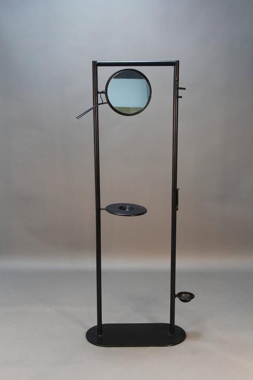 Designer coatrack from Fly Line in Carre Italy with swivel mirror, change or key cup, and swivel umbrella receiver.