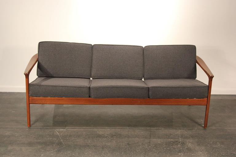 Reupholstered and refinished sofa by Folke Ohlsson for Dux of Sweden.
