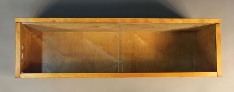Rare display case designed by Alvar Aalto for Artek Finland.  Pruchased at Chicaogo's Baldwin Kingrey in 1955.  During the 1950s, while Aalto was teaching at MIT, the Midwest franchise obtained the regional exclusive for Aalto's Artek furniture