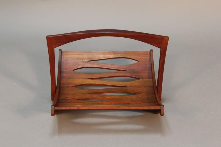 Beautiful staved teak magazine rack designed by Jens Quistgaard for Dansk.  Teardrop shaped cutout design.  Signed with branded