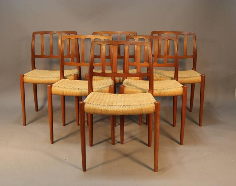 Set of six teak dining chairs with Danish paper chord seats. Stamped under seats. Niels Otto Møller for J. L. Møller. Excellent original condition, some light wear from use. Original, 1960s.