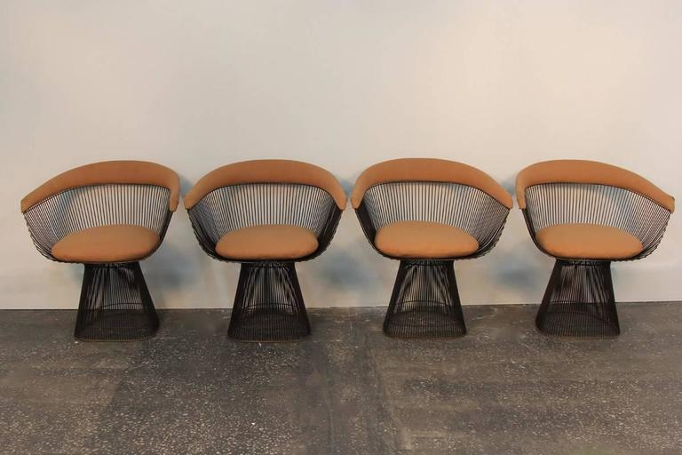 Beautiful original bronze. Set of four dining or side chairs. Needs reupholstery, which can arrange for you, or sell as is.