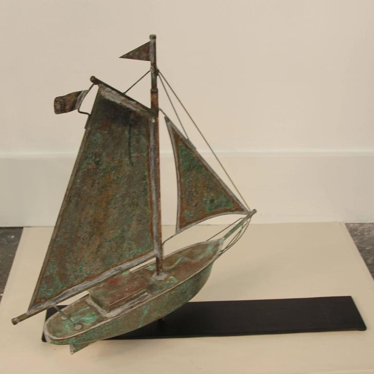 Lovely aged filigree copper sailboat weathervane boat sculpture.