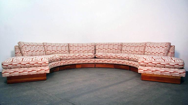 Exceptional and rare circular sofa by Erwin Lambeth for John Stuart composed of four sections on cherrywood bases. Fantastic Mid-Century design and great useful size.  Individual sections measure 26.5 H x 32 D x 71 W and 17 Seat Height Overall as