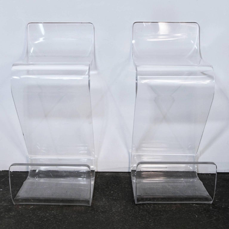 Incredible pair of Mid-Century Lucite Z-shaped stools. 1 inch thick Lucite. Very heavy. Rare set of stools that will make an amazing impression for any counter or bar area.