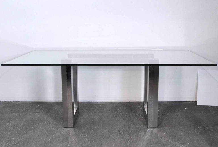 Mid Century chrome case dining table with glass top. Very much in the style of Paul Evans cityscape or Ello designs. Could be one of the two, but don't know for certain. Base is heavy and glass sits on top. Glass can be swapped out for different