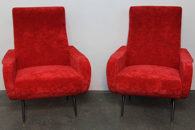 Italian style club chairs with crushed red velvet upholstery. Enabled steel legs with brass detail. Excellent condition, Italian style, in contemporary chairs.