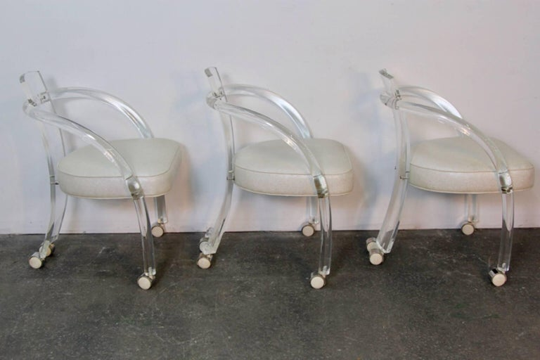 Chic set of six in the style of Charles Hollis Jones, Lucite armchairs. Newly upholstered with faux shagreen, on white castors. Lucite is very clear and in good condition for its age.