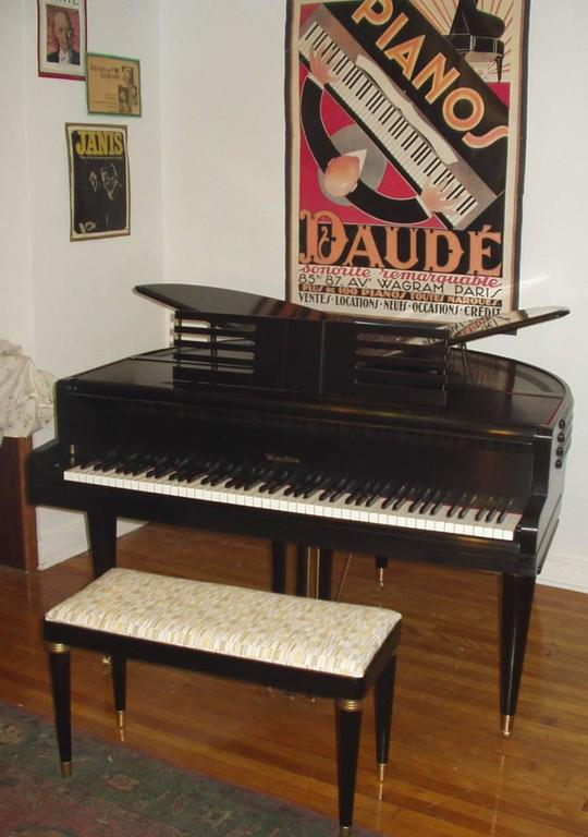 "4'1"" symetrical baby grand piano with matching bench.