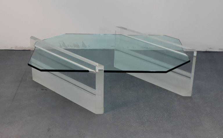 Incredible and very rare glass top coffee table with heavy, 2 inch thick Lucite base. Partially frosted, and partially clear with slits for glass insert. Amazing piece.
