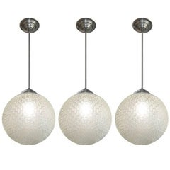 French Modernist Glass Globe Shaped Chandeliers one two or three