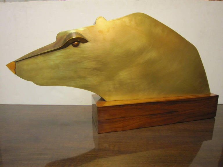 Very large Art Deco angular, cubist statue of an animal in brass with copper accents resting on the original thick rosewood plinth,  stamped on the underside Austria.  Highly Minimalist in design, elegantly simple in form, figurative yet abstract