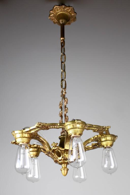 this 1920s cast brass fixture in the neoclassical style is no longer