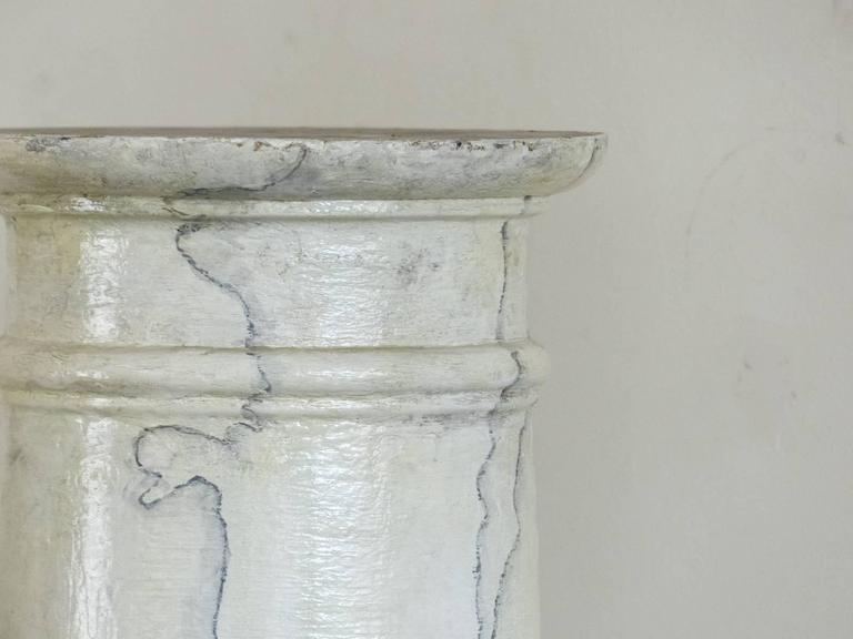 Set of eight wooden columns salvaged from a site in Ontario. These wooden accent pieces are complete with caps and bases and are in a faux marble grain paint. The surface is age cracked showing excellent texture.