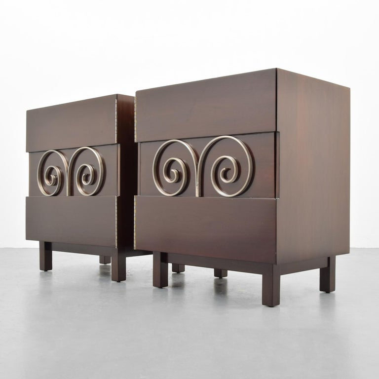 Pair of cabinets or nightstands by Edmond Spence.   Materials: Mexican mahogany, nickelled brass  Markings: Branded marks.