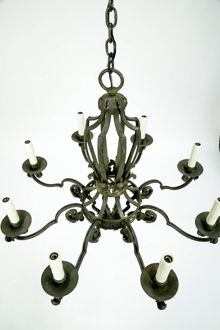 This Dignified Eight Light Chandelier Is Made From Hand Forged Wrought Iron In