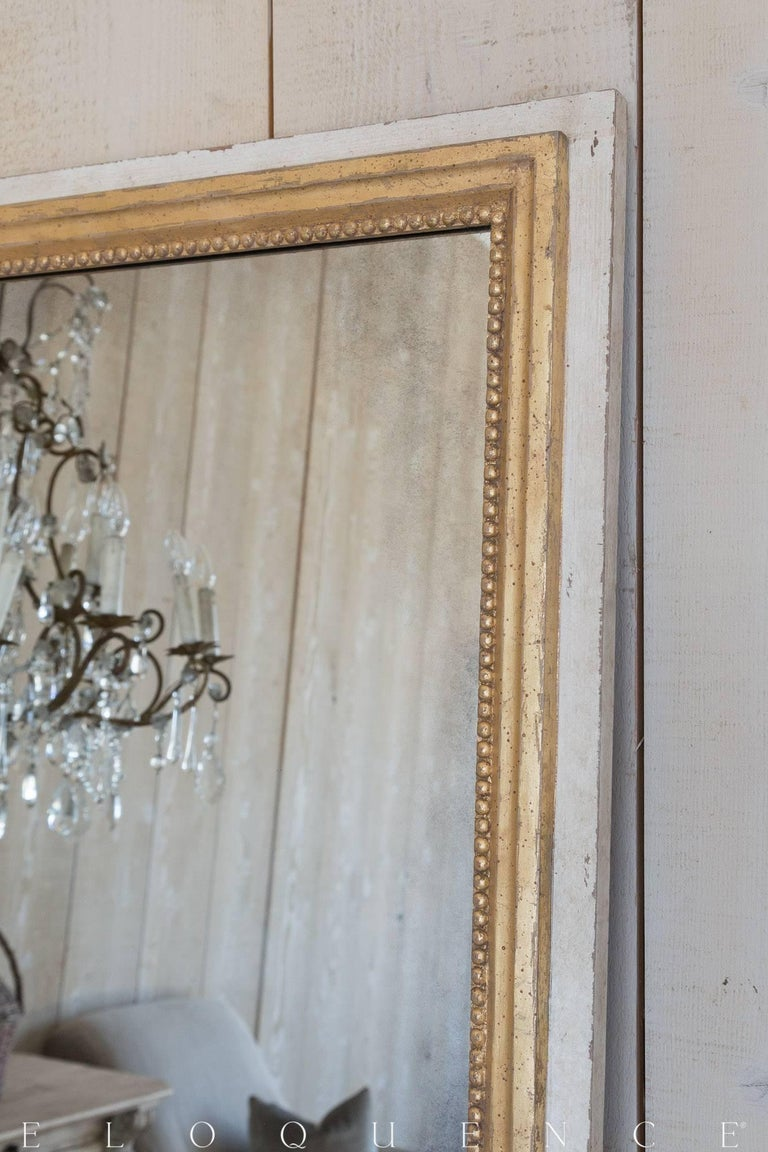 Eloquence® Grande Eugenie Panel Mirror in Toasted Almond. This gorgeous Grande mirror will fill your space with luxury and light. The hand aged glass and hand finished frame are classically designed, with lovely beading adorning the inner edges.