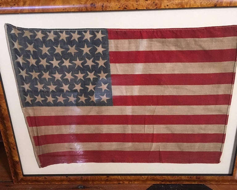 Antique American parade flag with 46 stars, made when