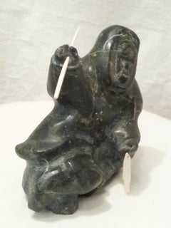 Soapstone Inuit with Bone Fish