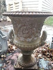 Iron garden urn with painted outside
