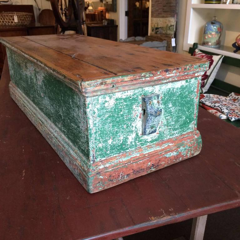 Sea chest in green paint with natural wood top.